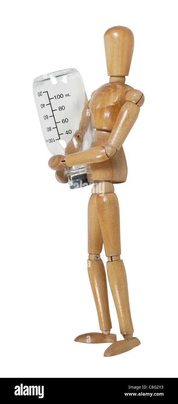 Modello che trasportano un medico di una bottiglia di vetro con le misurazioni di fluido scritto su entrambi i lati Immagini Stock