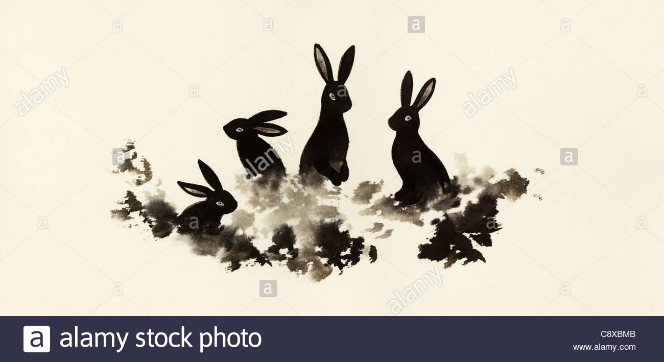 I conigli di seduta in erba insieme Immagini Stock