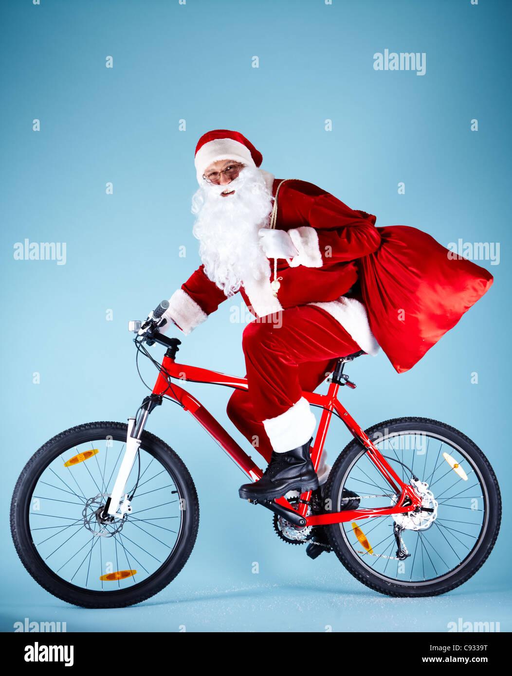 Babbo Natale In Bicicletta.Foto Di Felice Babbo Natale Con Sacco Rosso Bicicletta Equitazione