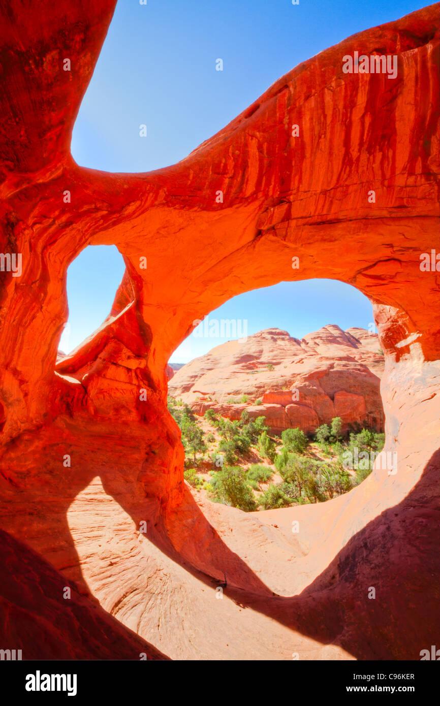 Spider Web Arch, Monument Valley Tribal Park, Arizona a caccia di Mesa, triplice arco in De Chelly arenaria Immagini Stock