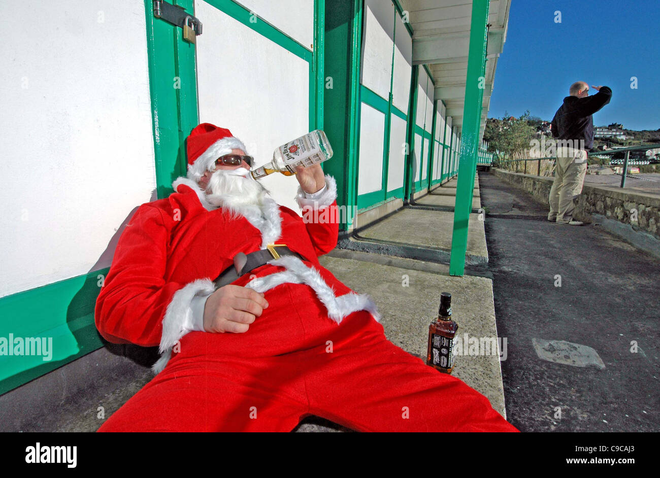 Babbo Natale Ubriaco.Ubriaco Babbo Natale Al Langland Bay Vicino A Swansea Mentre Un