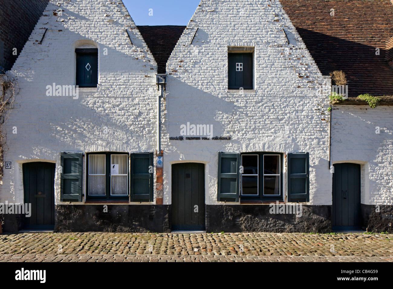 Il museo del folklore e il Gatto Nero / Zwarte Kat a Bruges, Belgio Immagini Stock