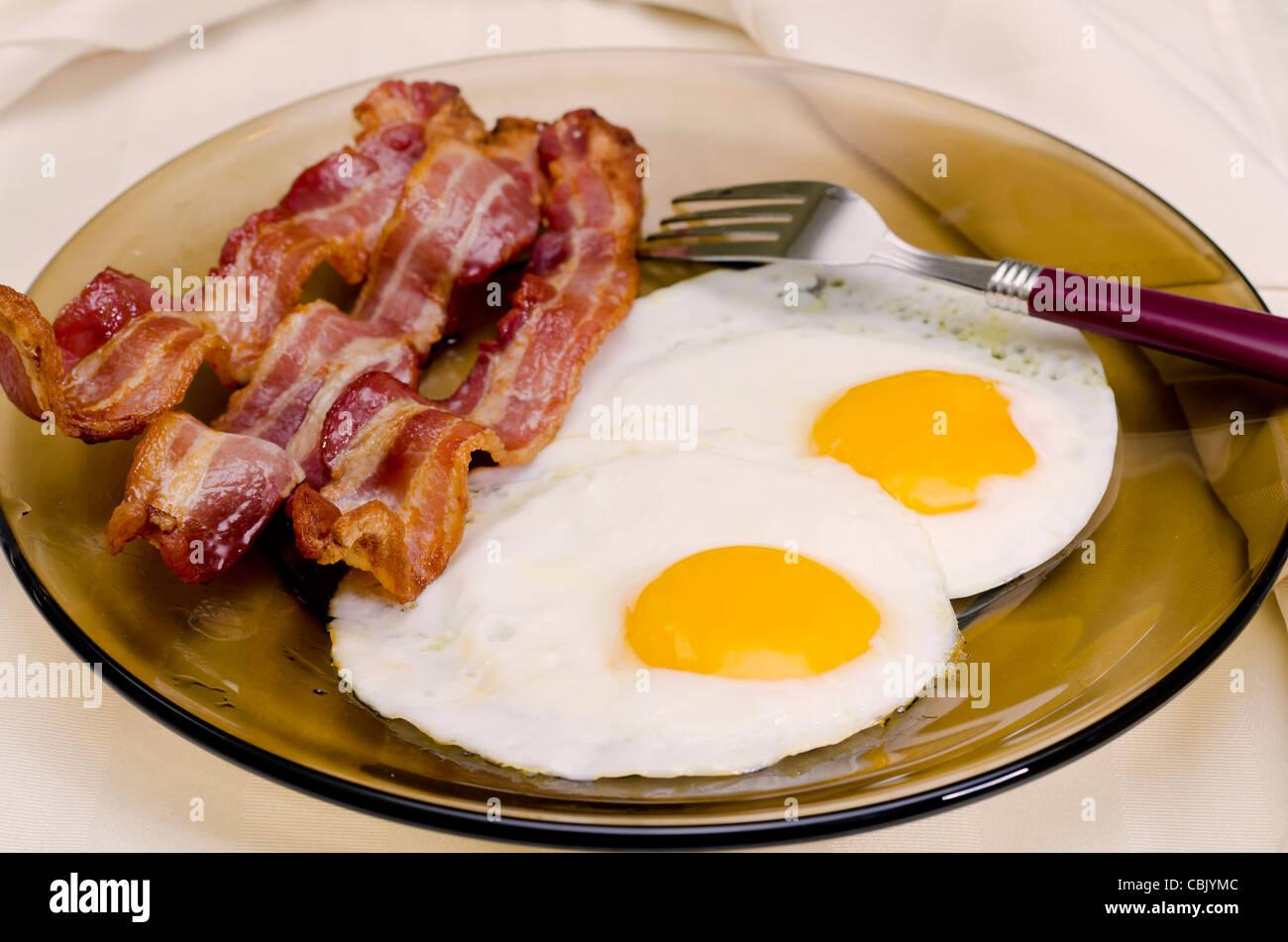 Uova fritte e pancetta Immagini Stock