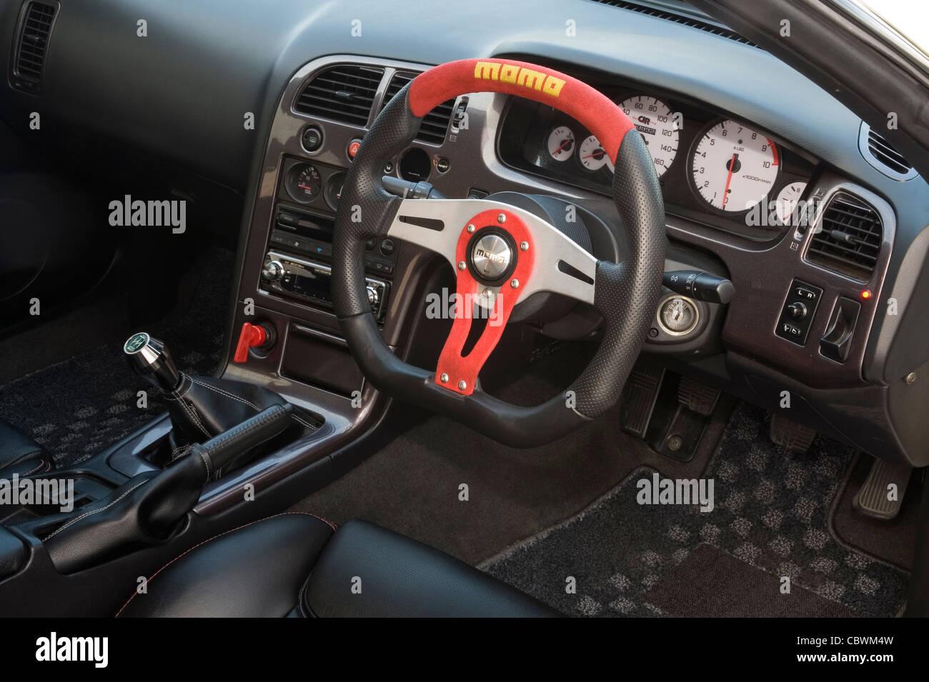 Fancy custom volante e cruscotto cruscotto nell'abitacolo di una vettura modificata Immagini Stock