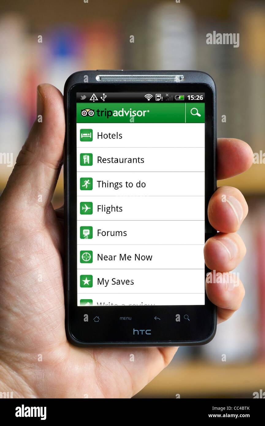 App di TripAdvisor su uno smartphone HTC Immagini Stock