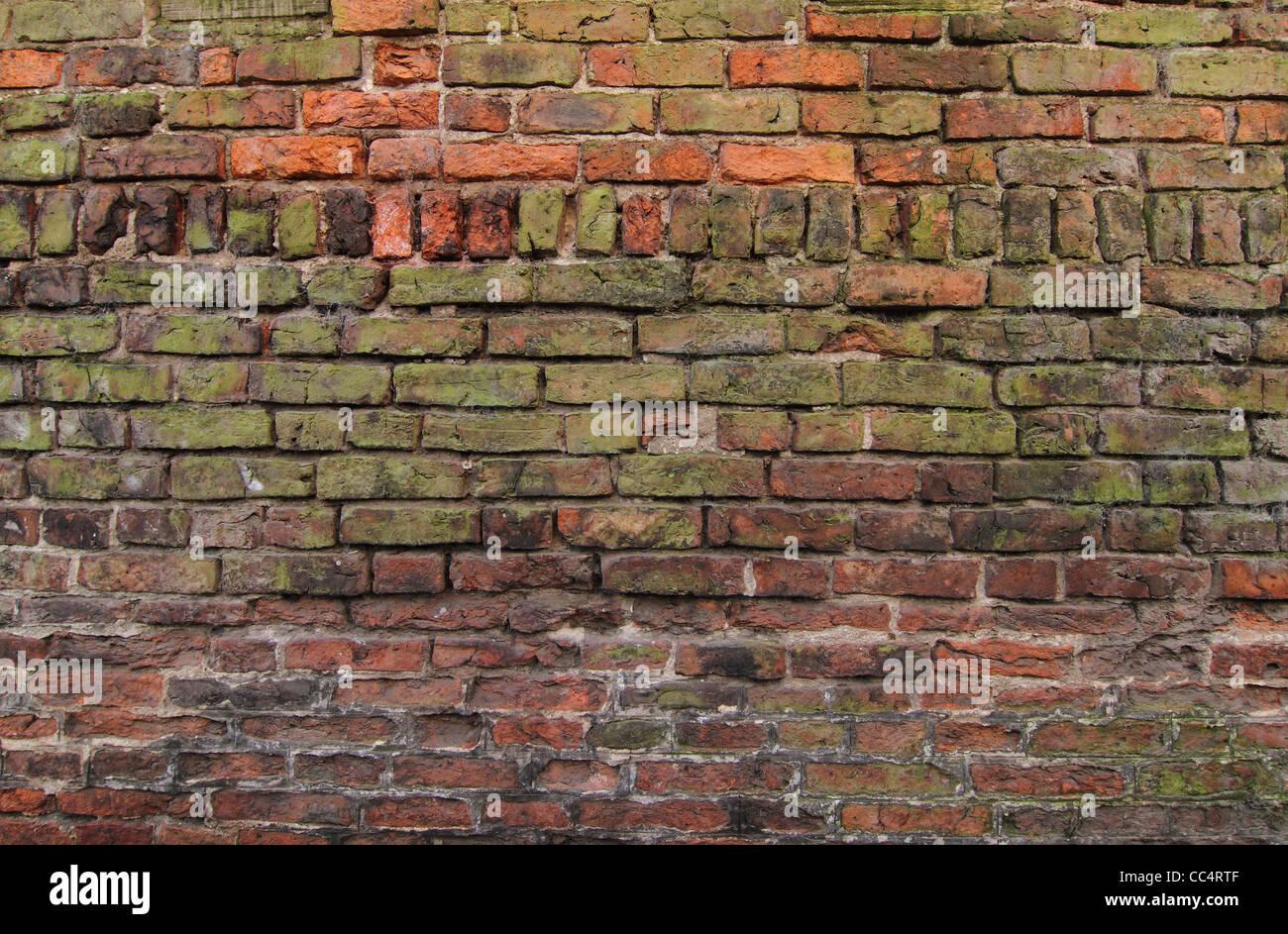 Rosso vecchio muro di mattoni Foto Stock
