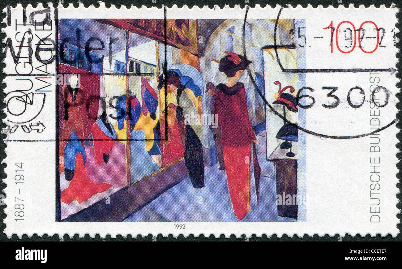 """Germania - circa 1992: un timbro stampato in Germania, mostra una foto di 'Fashion Shop"""", da August Macke Immagini Stock"""