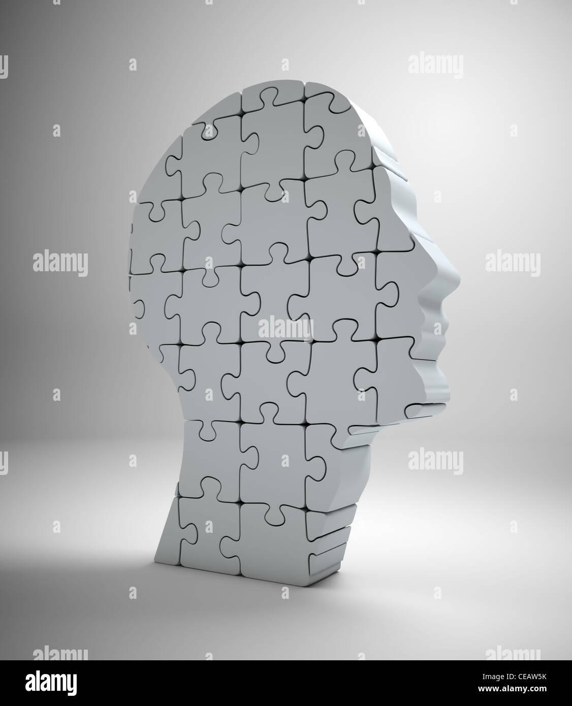 Una testa maschio nella creazione di pezzi di un puzzle Foto Stock