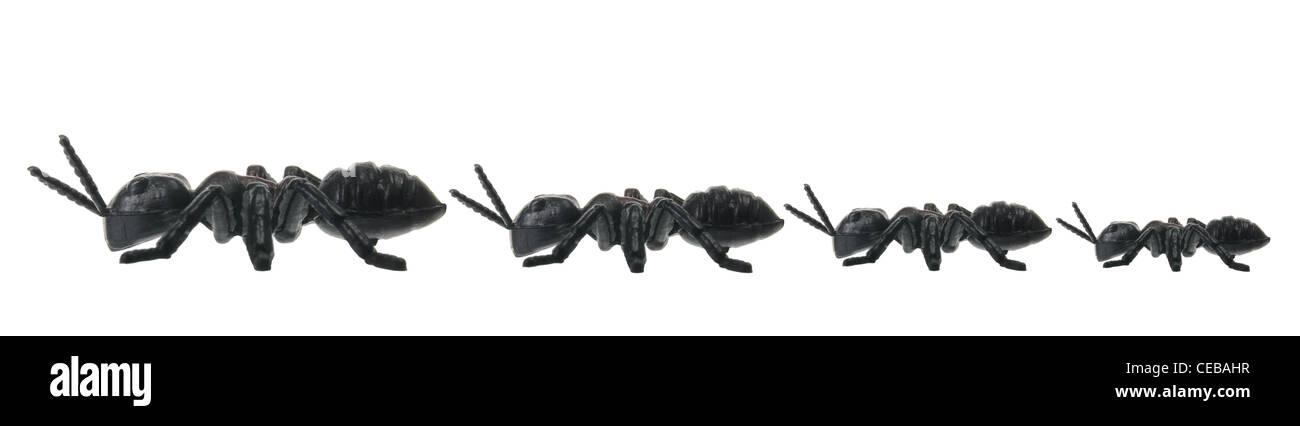 La linea di giocattoli le formiche Immagini Stock