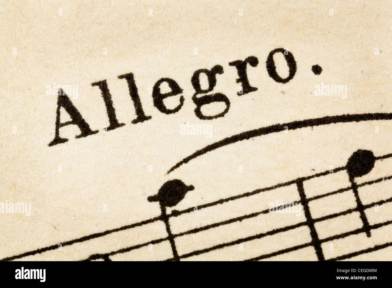 Allegro - fast, rapidamente e luminosa tempo musicale - macro dettaglio dal vintage sheet music Immagini Stock