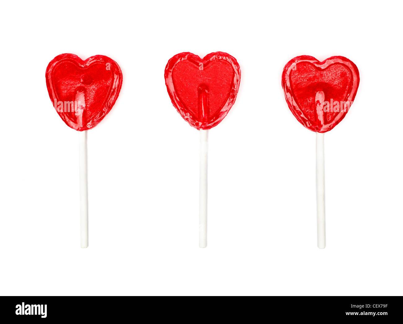 Tre a forma di cuore ad lollies Immagini Stock