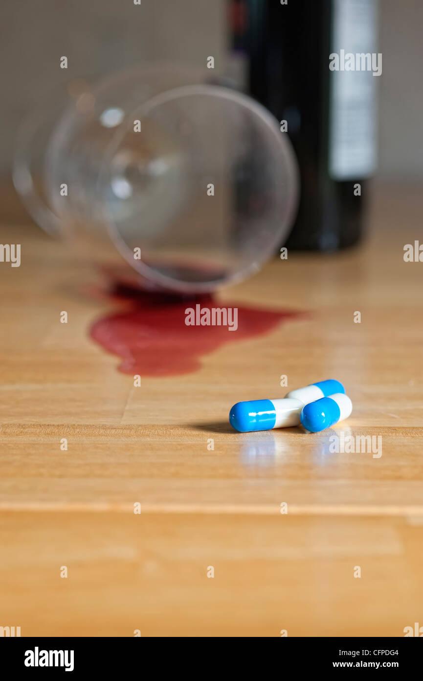 La dipendenza da alcol e droghe Immagini Stock
