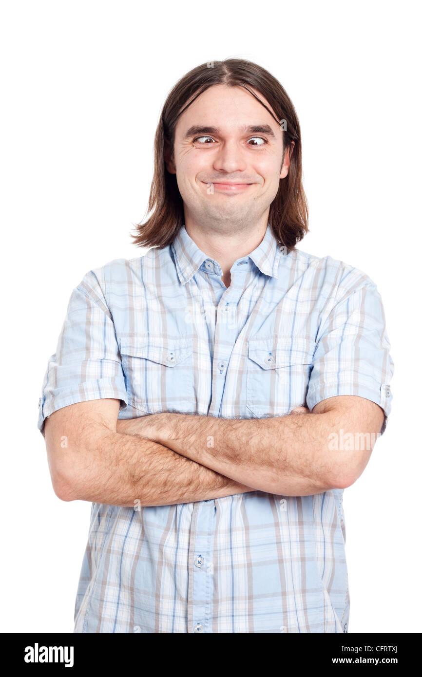 Ritratto di funny attraversato eyed uomo facendo facce buffe, isolato su sfondo bianco. Immagini Stock