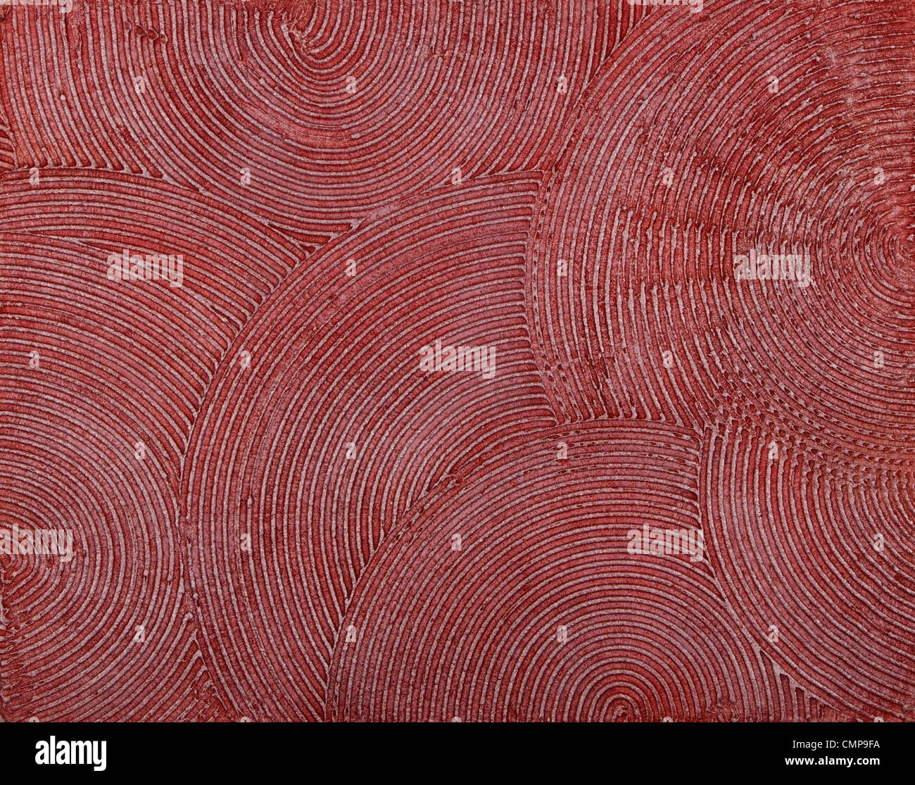 Parete texture con una profonda dabs circolare di putty, coperto con vernice rossa. Immagini Stock
