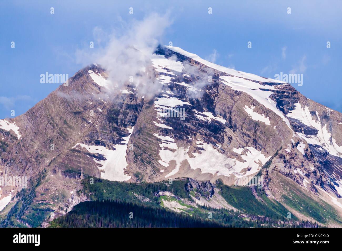 Il cielo del picco di montagna nel Parco Nazionale di Glacier nel Montana. Immagini Stock