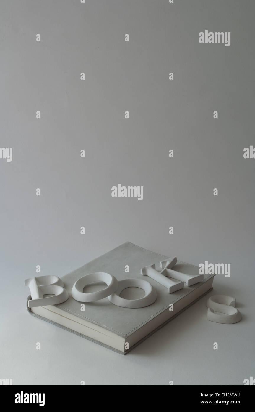 Libro bianco con la parola 'Libri' su di esso Immagini Stock