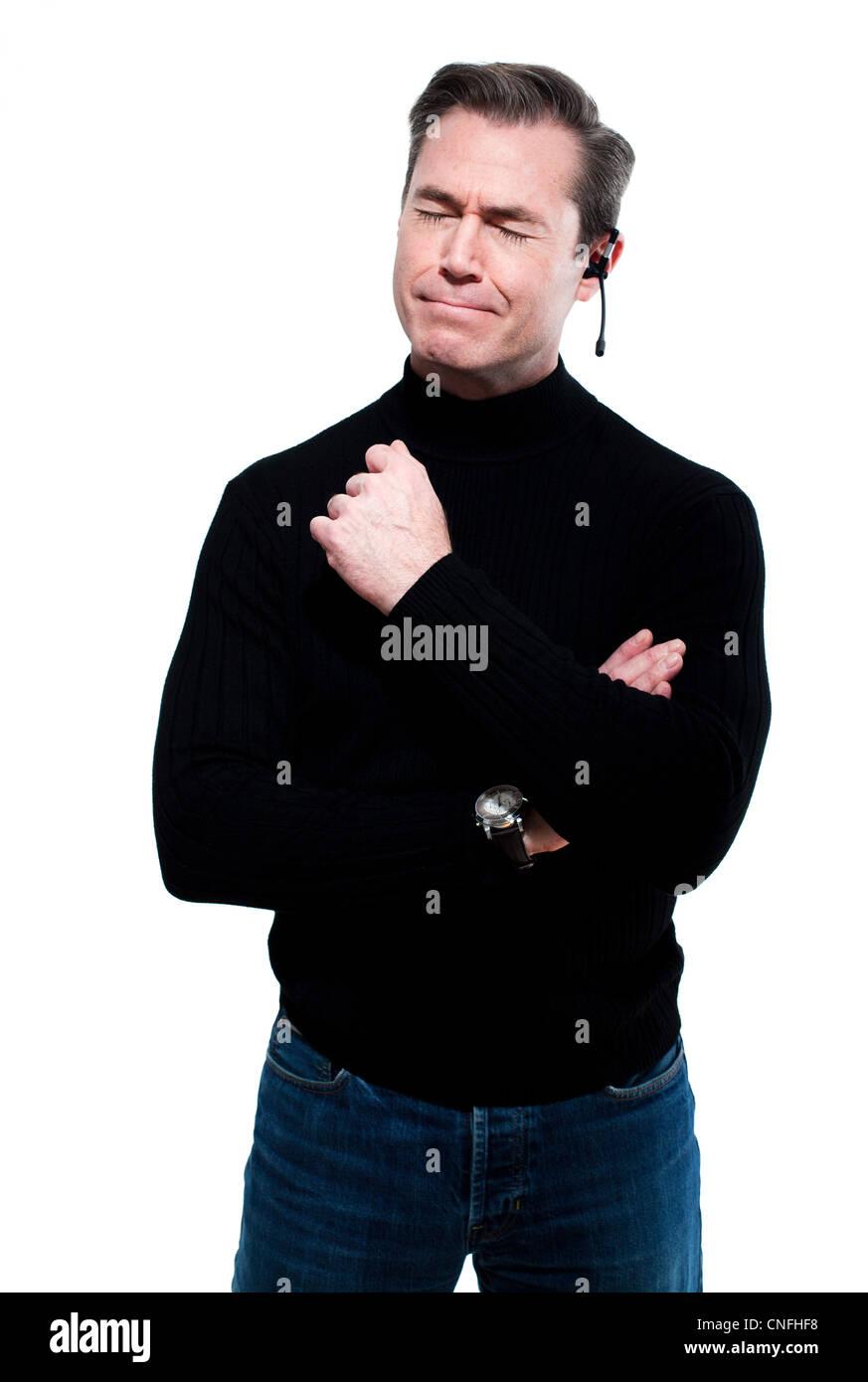 Uomo con espressione di cordoglio, indossando le cuffie Immagini Stock