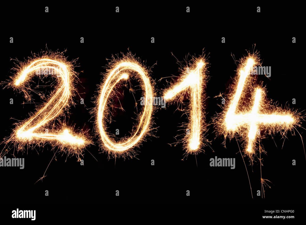 Una pittura di luce dell'anno 2014 scritte contro uno sfondo nero Immagini Stock
