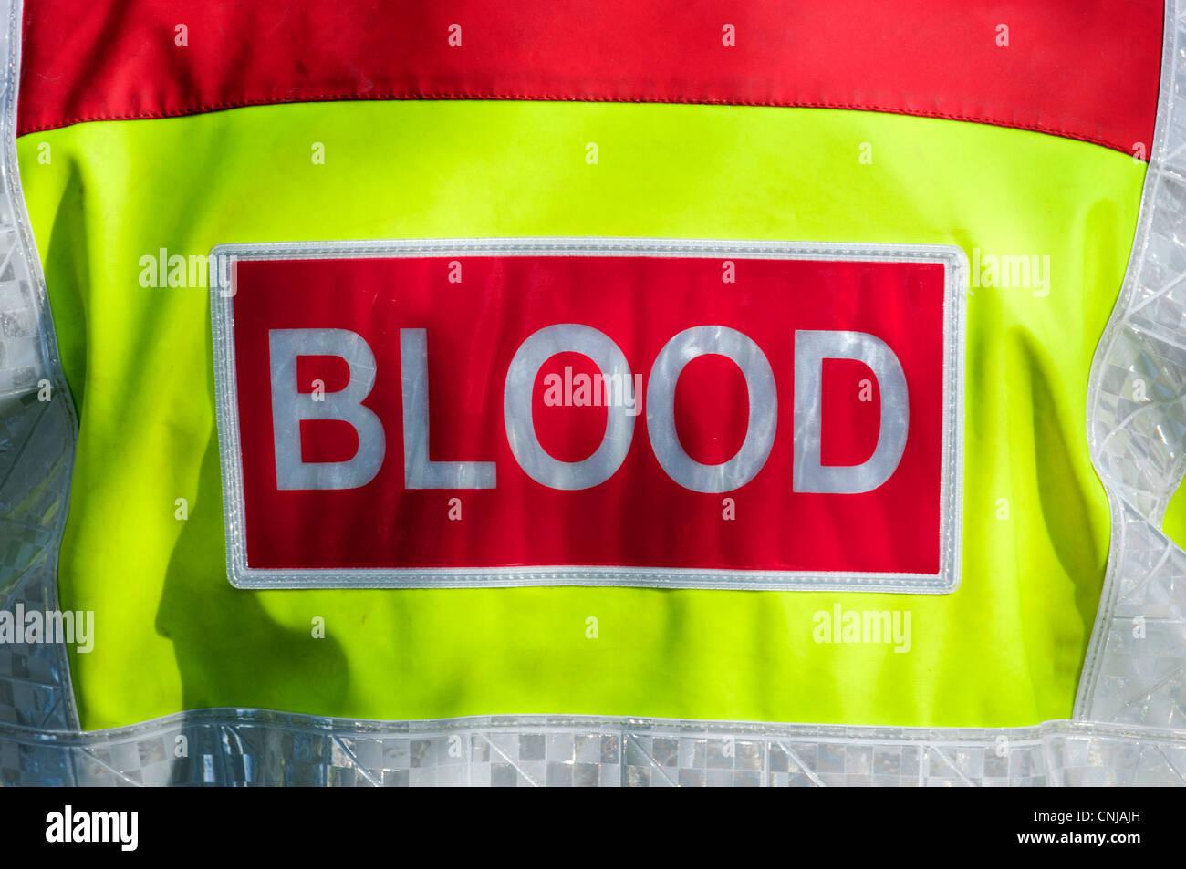 Il sangue di alta visibilità giacca paramedico Immagini Stock