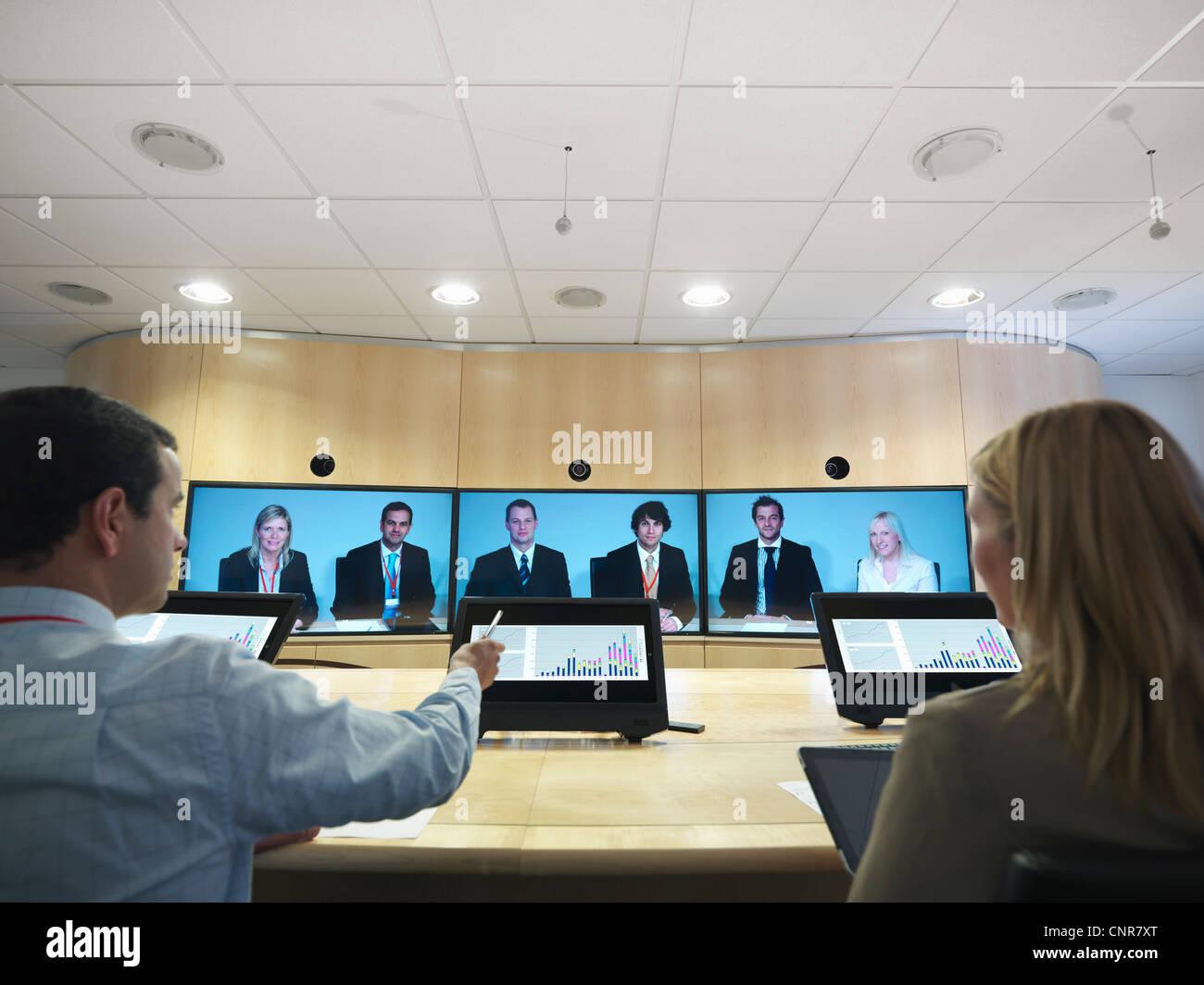 La gente di affari di video conferenza Immagini Stock