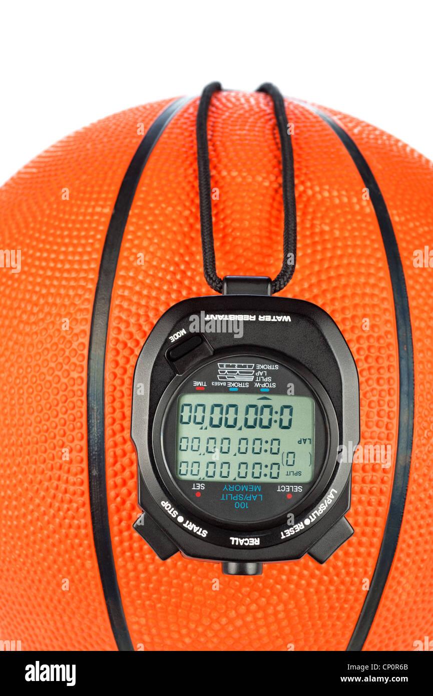 Una palla da basket tema sport con un cronometro digitale per l'uso con la maggior parte delle inferenze sportivo Immagini Stock