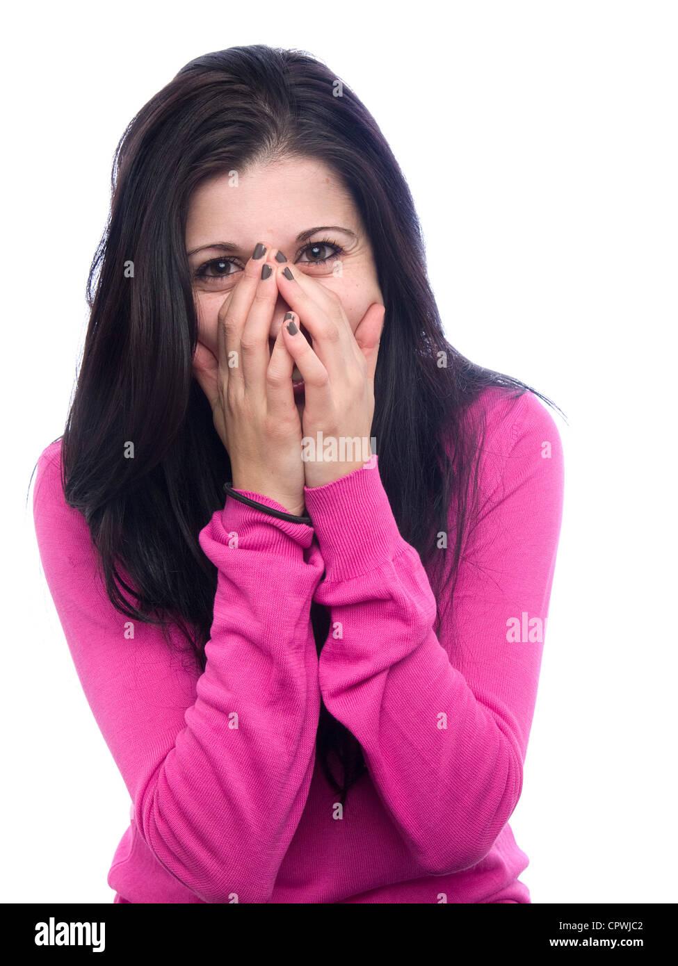 Ritratto di shy giovane donna con le mani che ricopre la faccia Immagini Stock