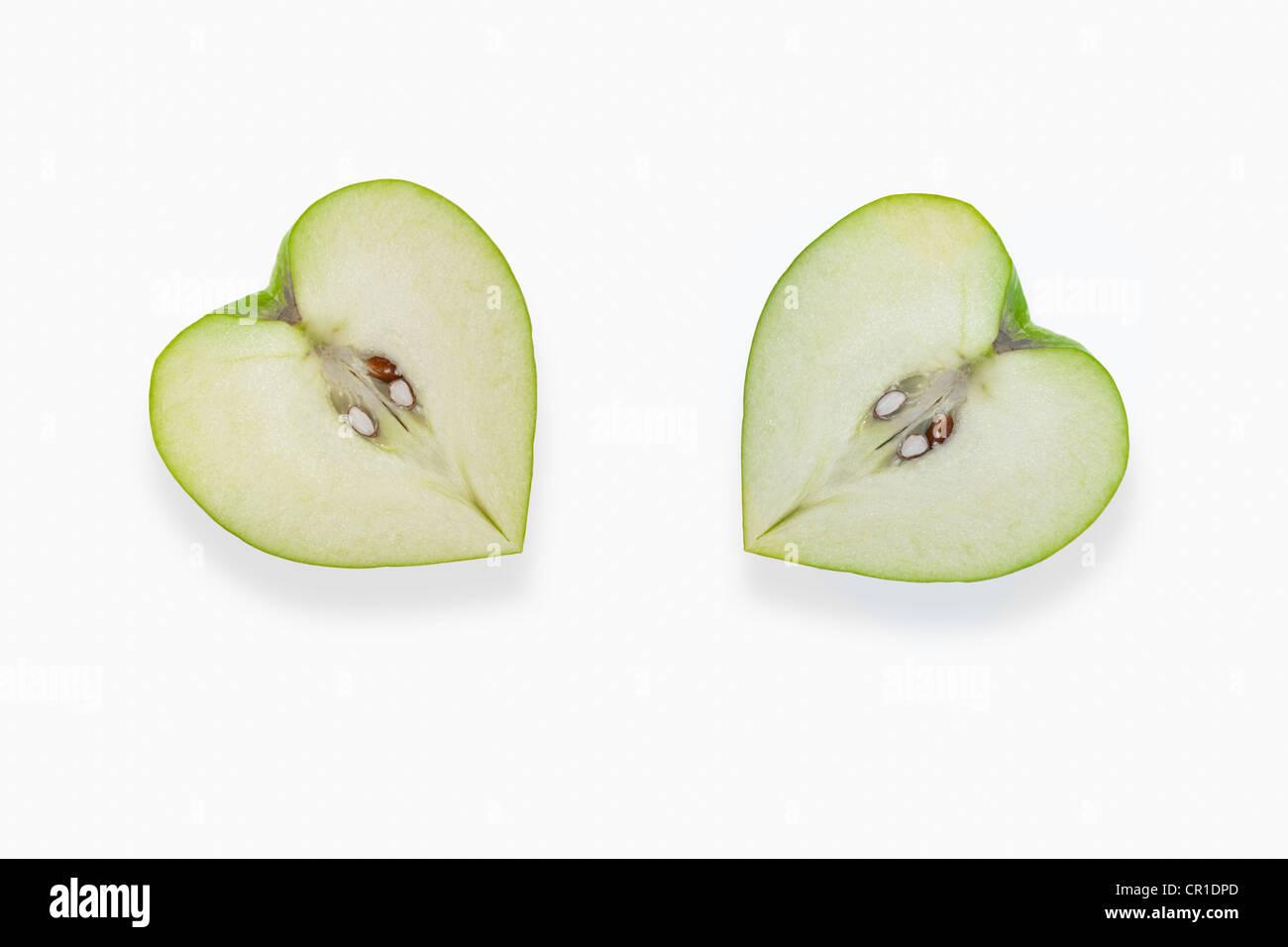 A forma di cuore le mele Immagini Stock