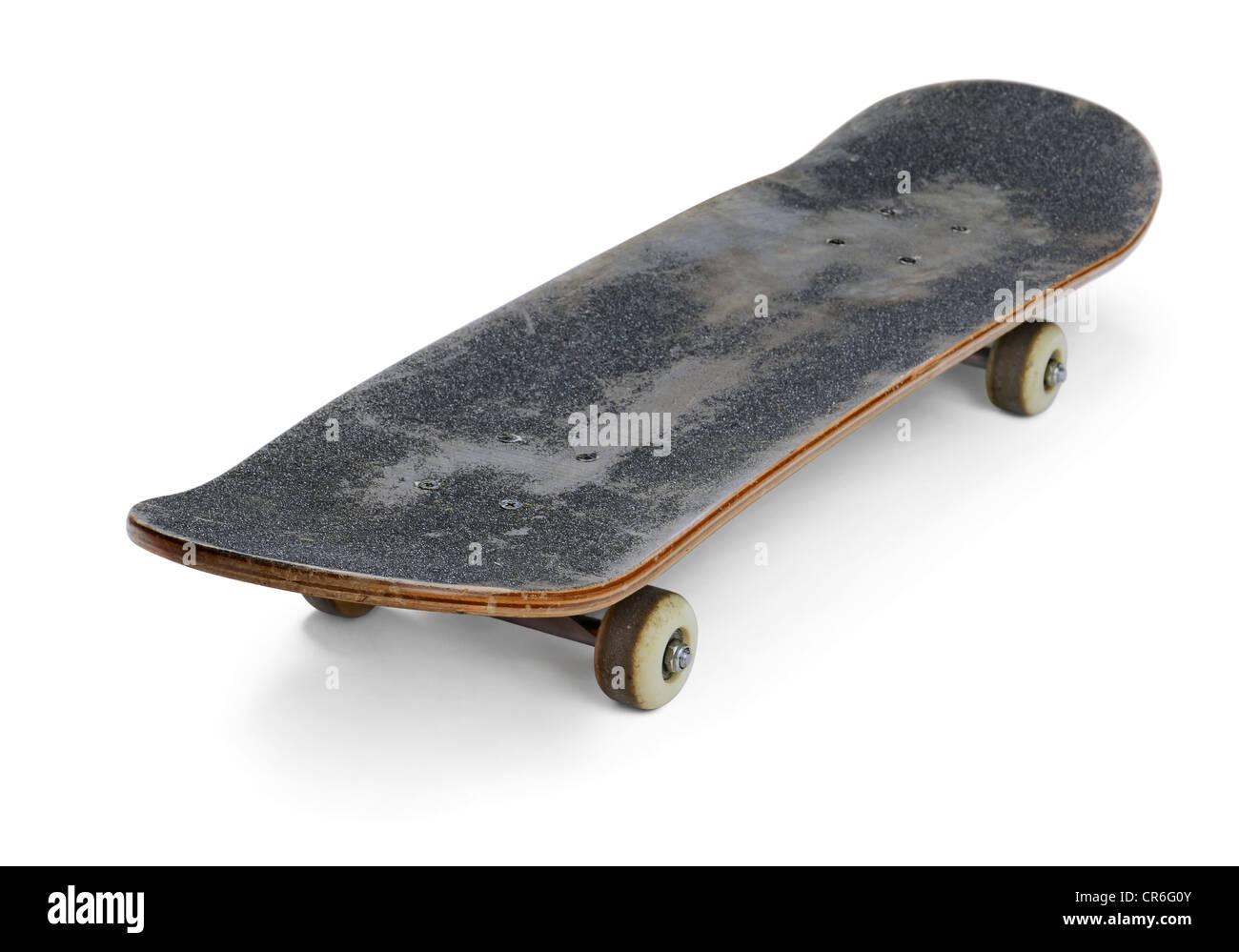 Vecchio usato skateboard isolato su bianco Immagini Stock