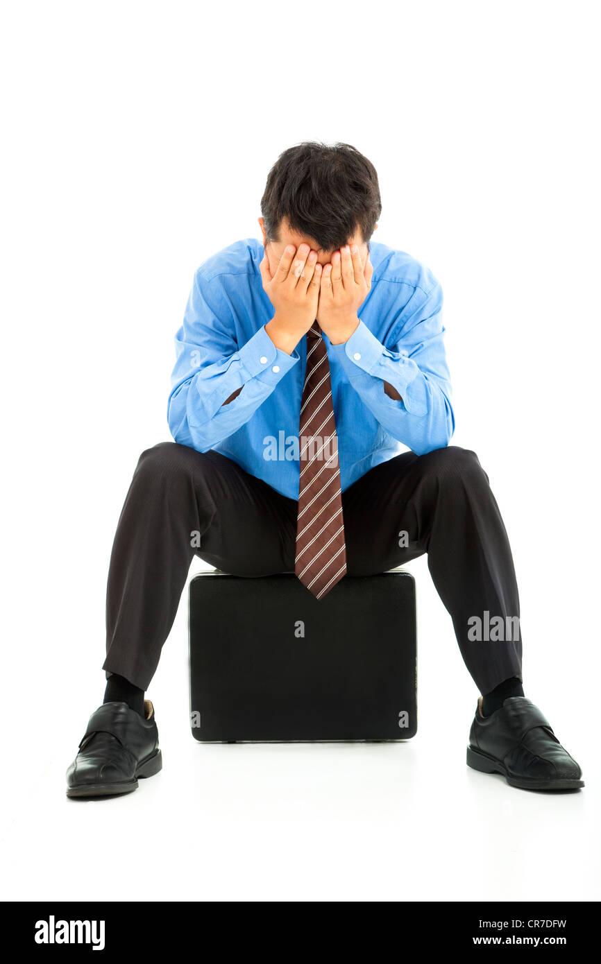 Imprenditore con le mani sul viso Immagini Stock
