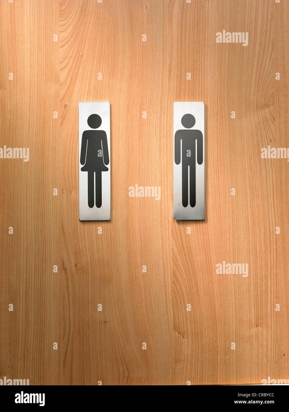 Maschio e femmina segni igienica su sfondo di legno Immagini Stock