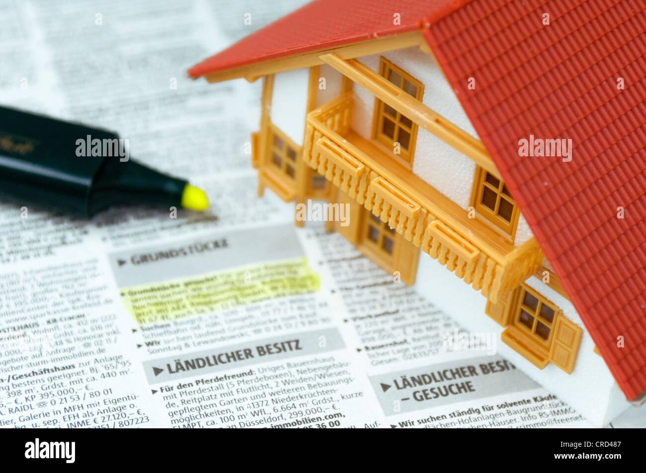 Modello di una casa su una richiesta di stampa Immagini Stock