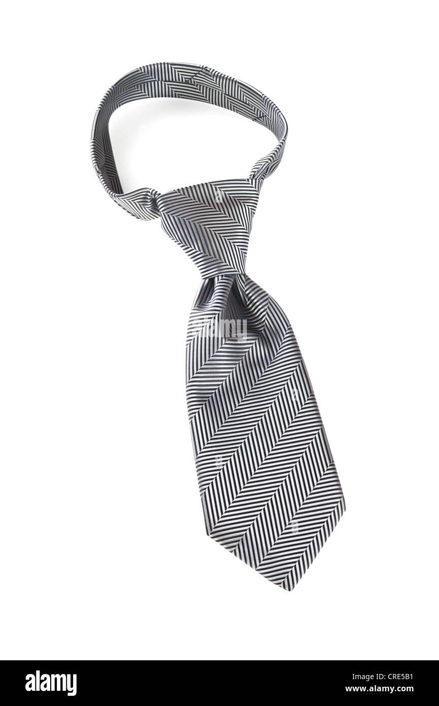 Cravatta grigio su bianco, con un nodo Windsor. Immagini Stock