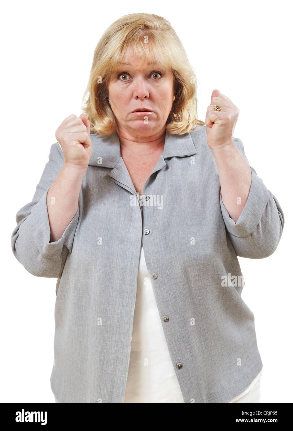 Arrabbiato donna matura, pugni e chiuse gli occhi rigonfiamenti Immagini Stock