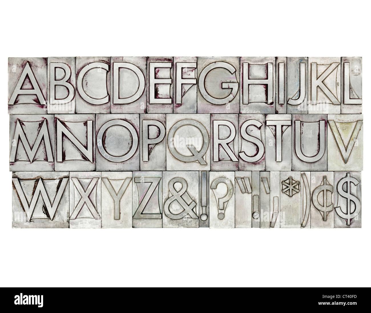 Alfabeto inglese, Dollar, cento e segni di punteggiatura nel vintage tipo di metallo Immagini Stock