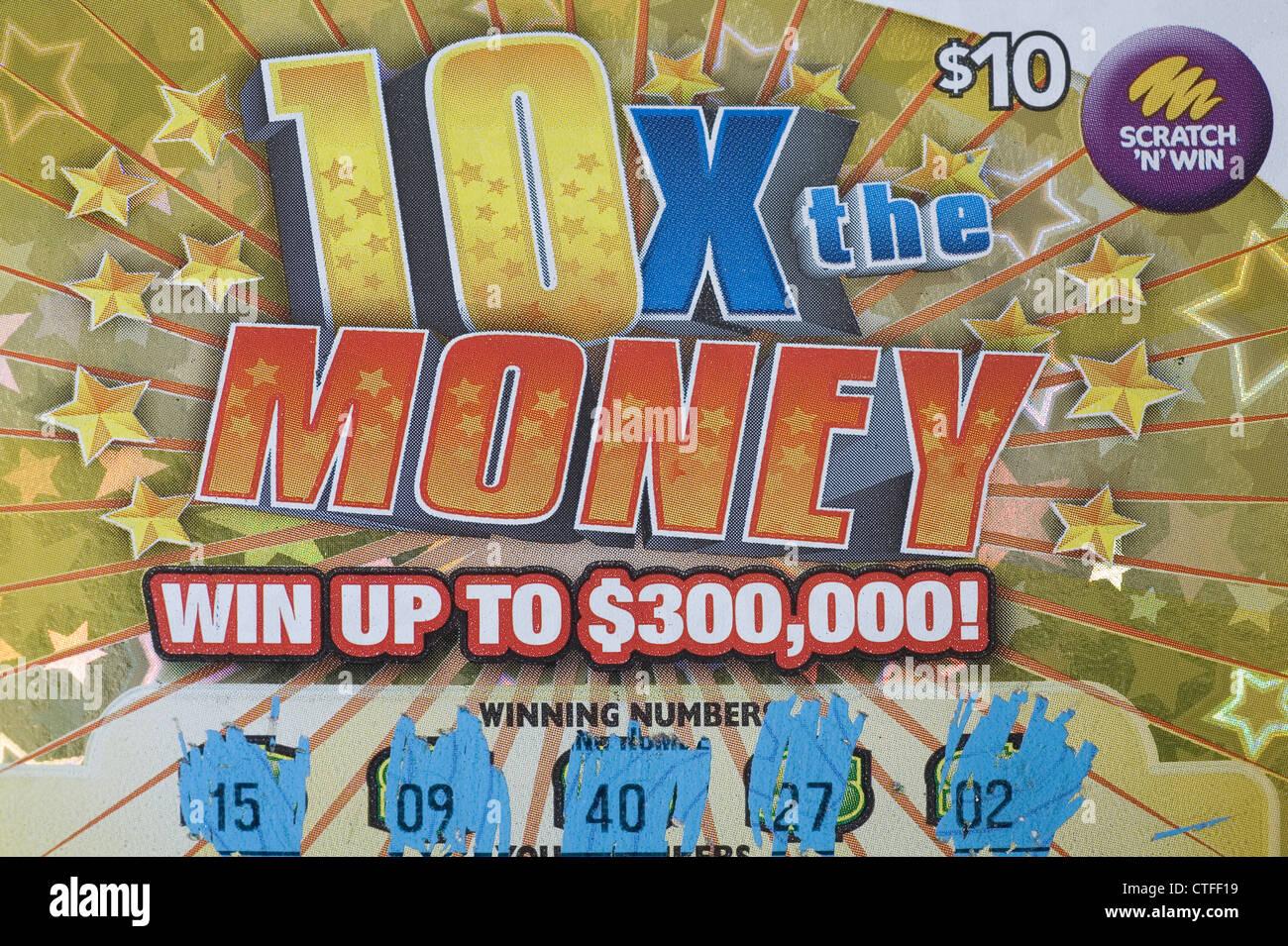 Scatch n' vincere lotto biglietto della lotteria promettente soldi grandi vincite. Immagini Stock