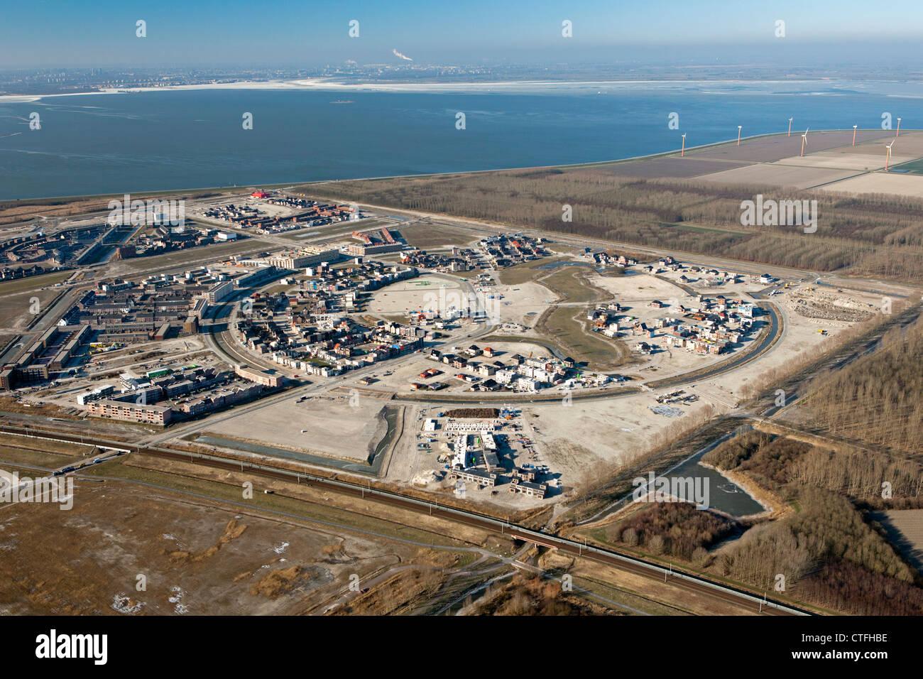I Paesi Bassi, Almere, costruzione di aree residenziali. Quartiere chiamato Almere Pampus. IJmeer. Antenna. Immagini Stock