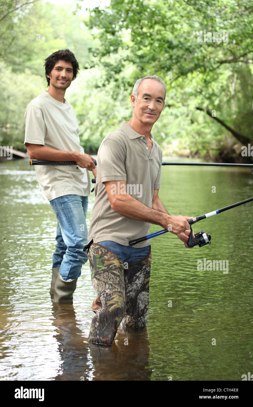 Senior e Junior la pesca sportiva Immagini Stock