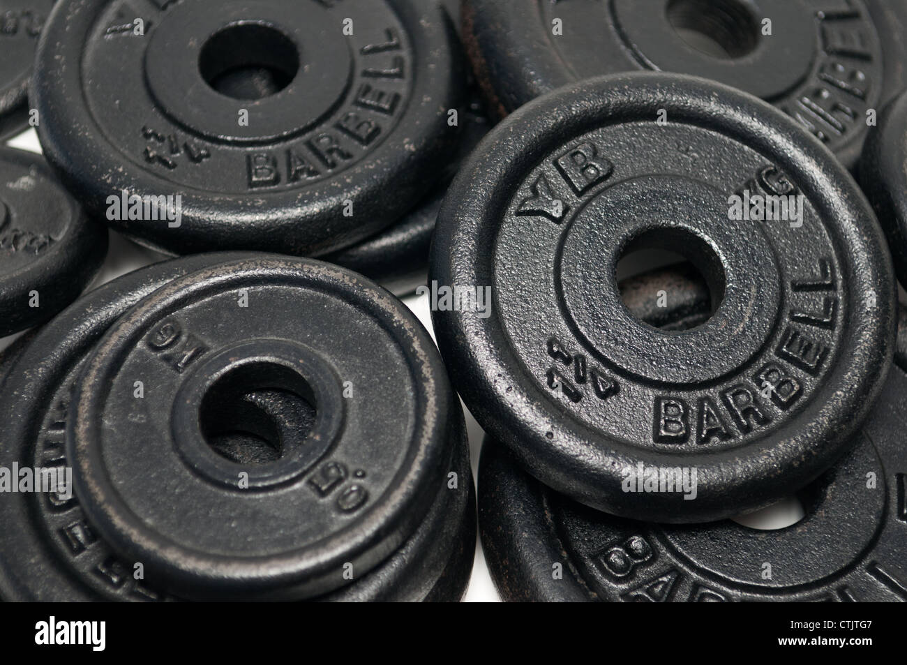 Pila di pesi dischi di peso Immagini Stock