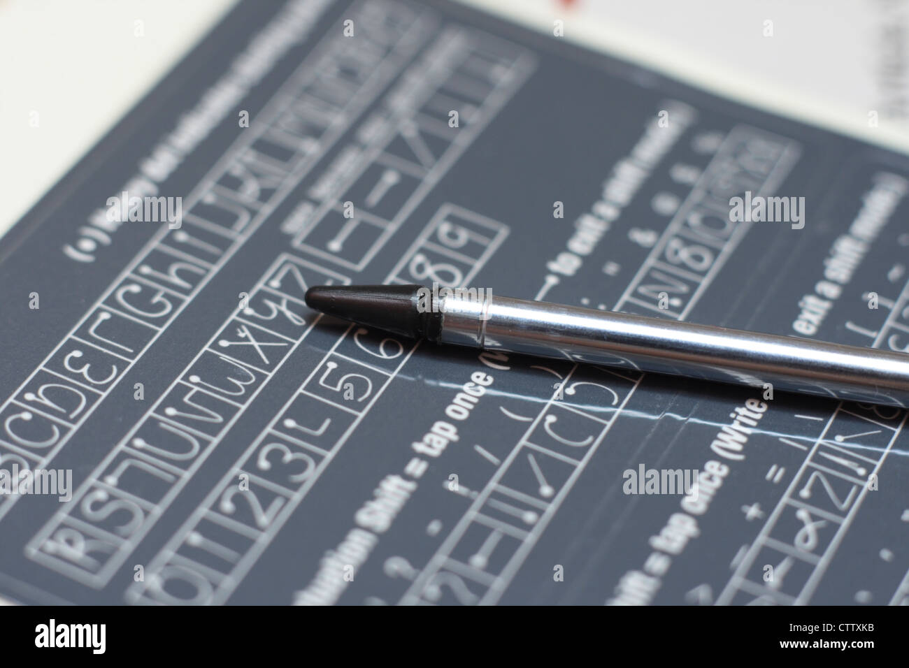 Pda stylus sulla guida della grafia Immagini Stock