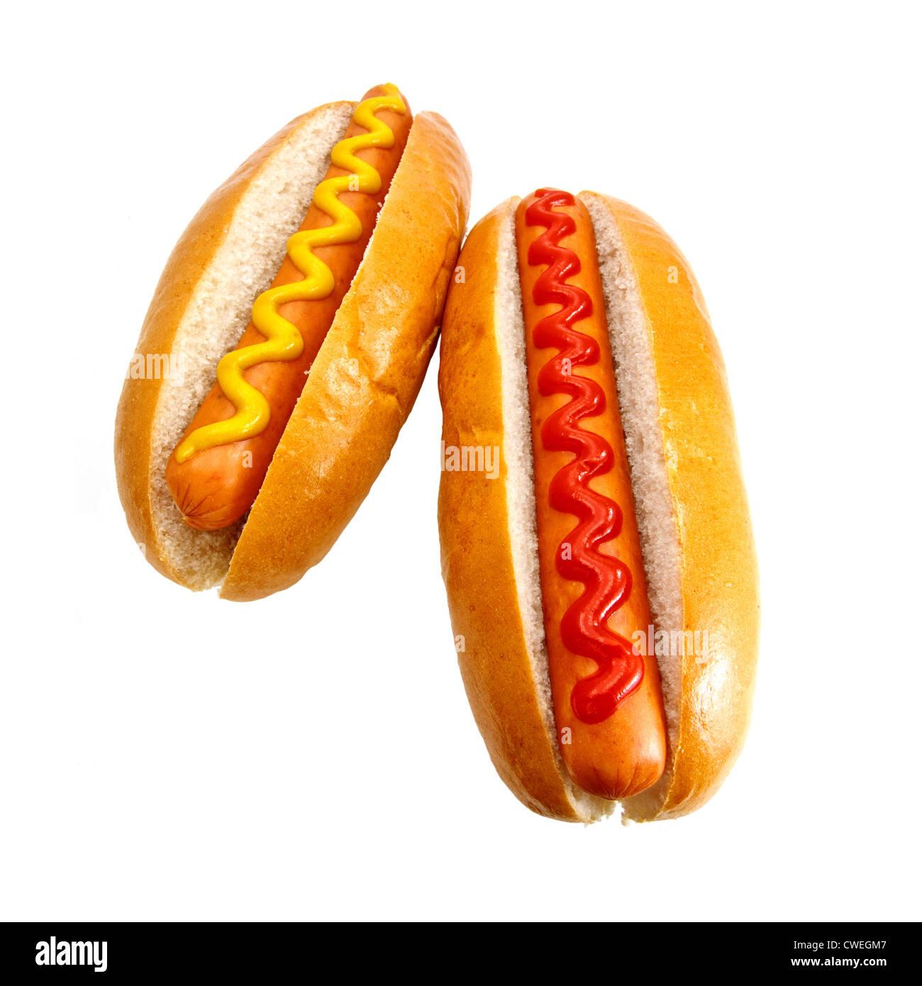 Hot Dogs o Wieners con senape e ketchup condimenti, l'originale classico prendere via il cibo Immagini Stock