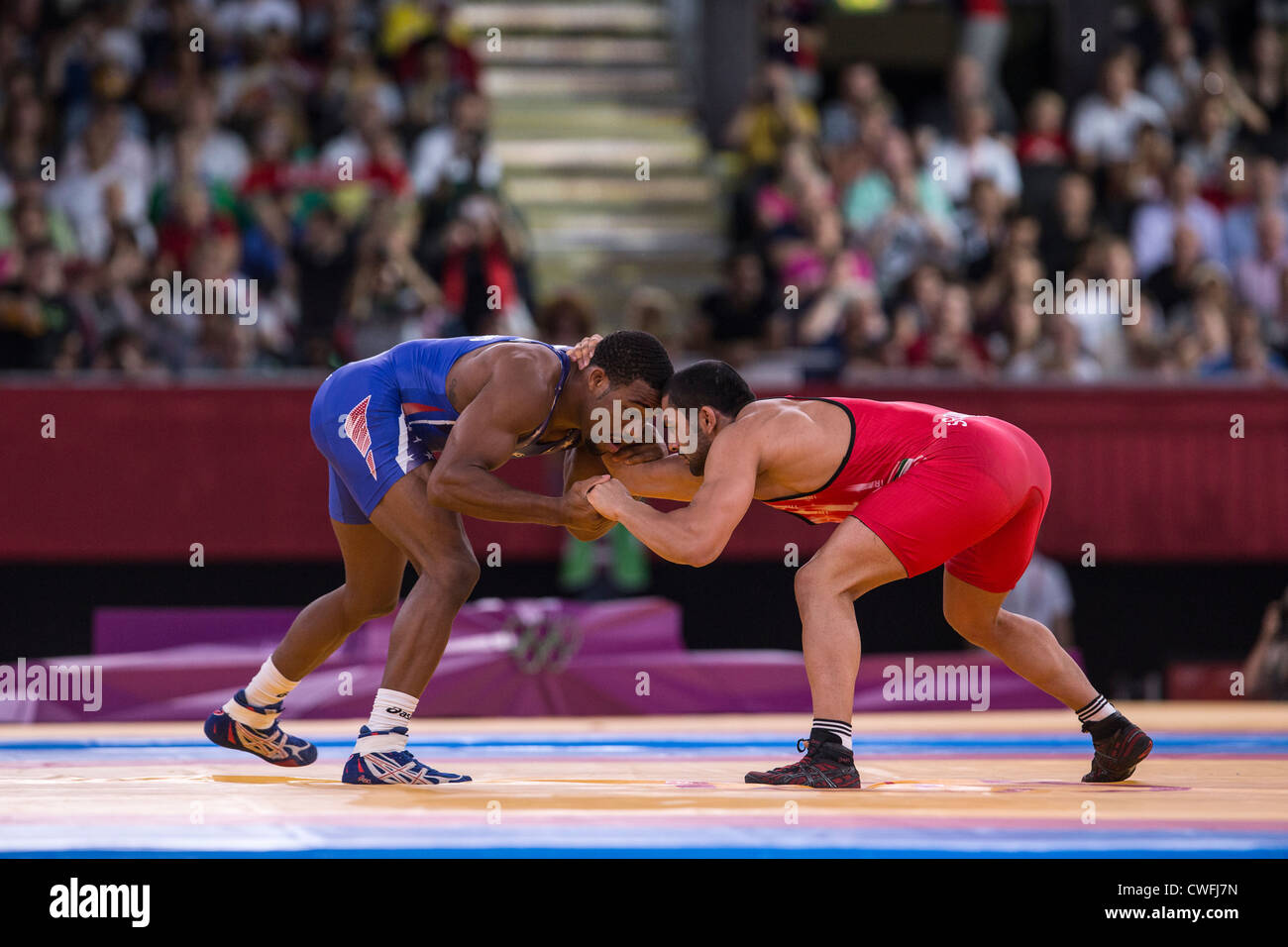 Giordano Ernest Burroughs (USA) -B- vs Sadegh Saeed Goudarzi (IRI) in Uomini 74kg Freestyle Wrestling all'Olympic Immagini Stock