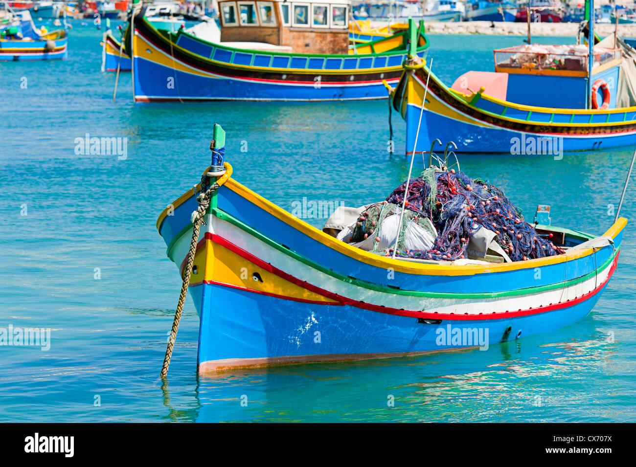 Le barche dei pescatori di Marsaxlokk malta Immagini Stock
