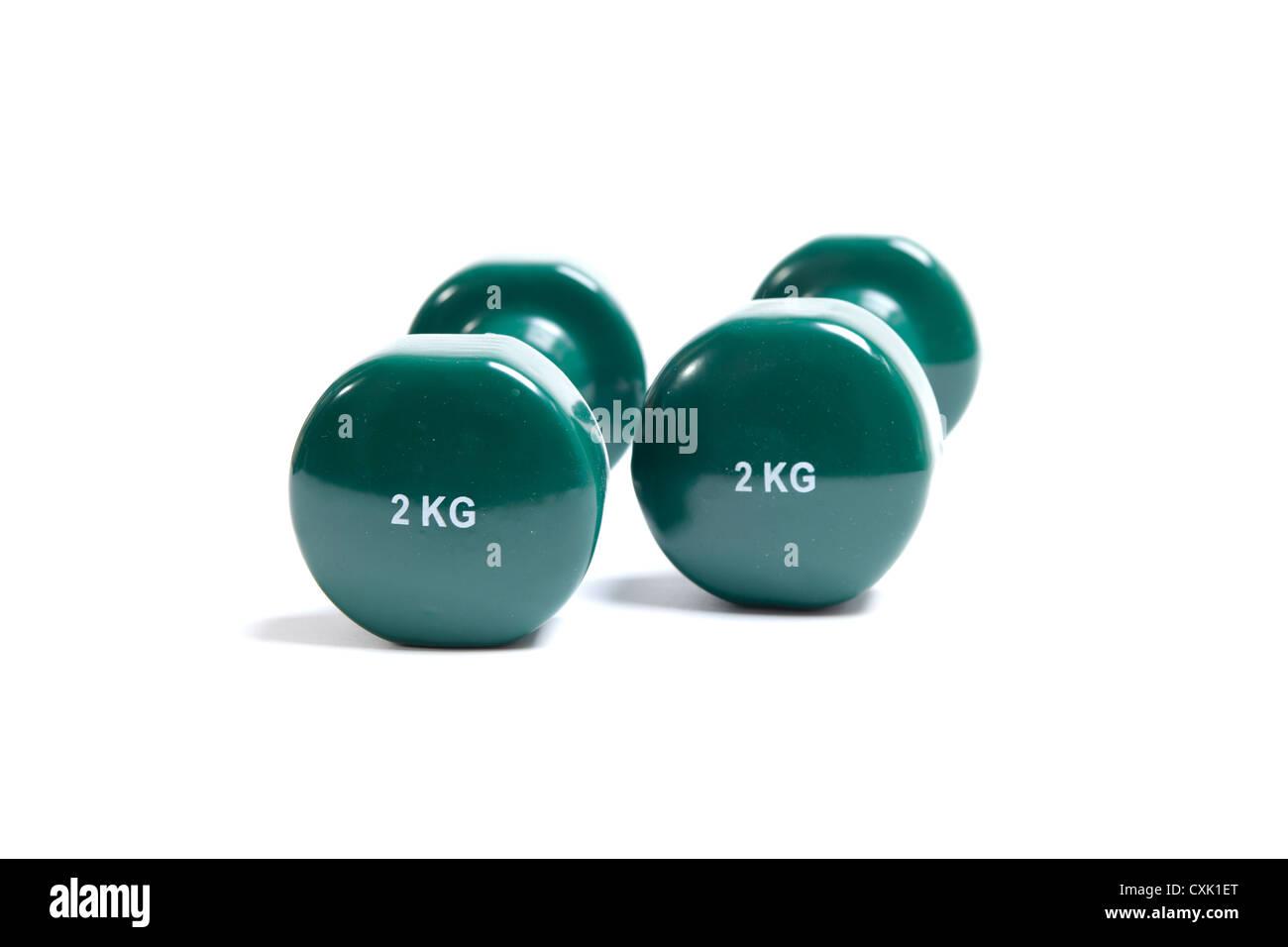 Due manubri verde di due chili Immagini Stock