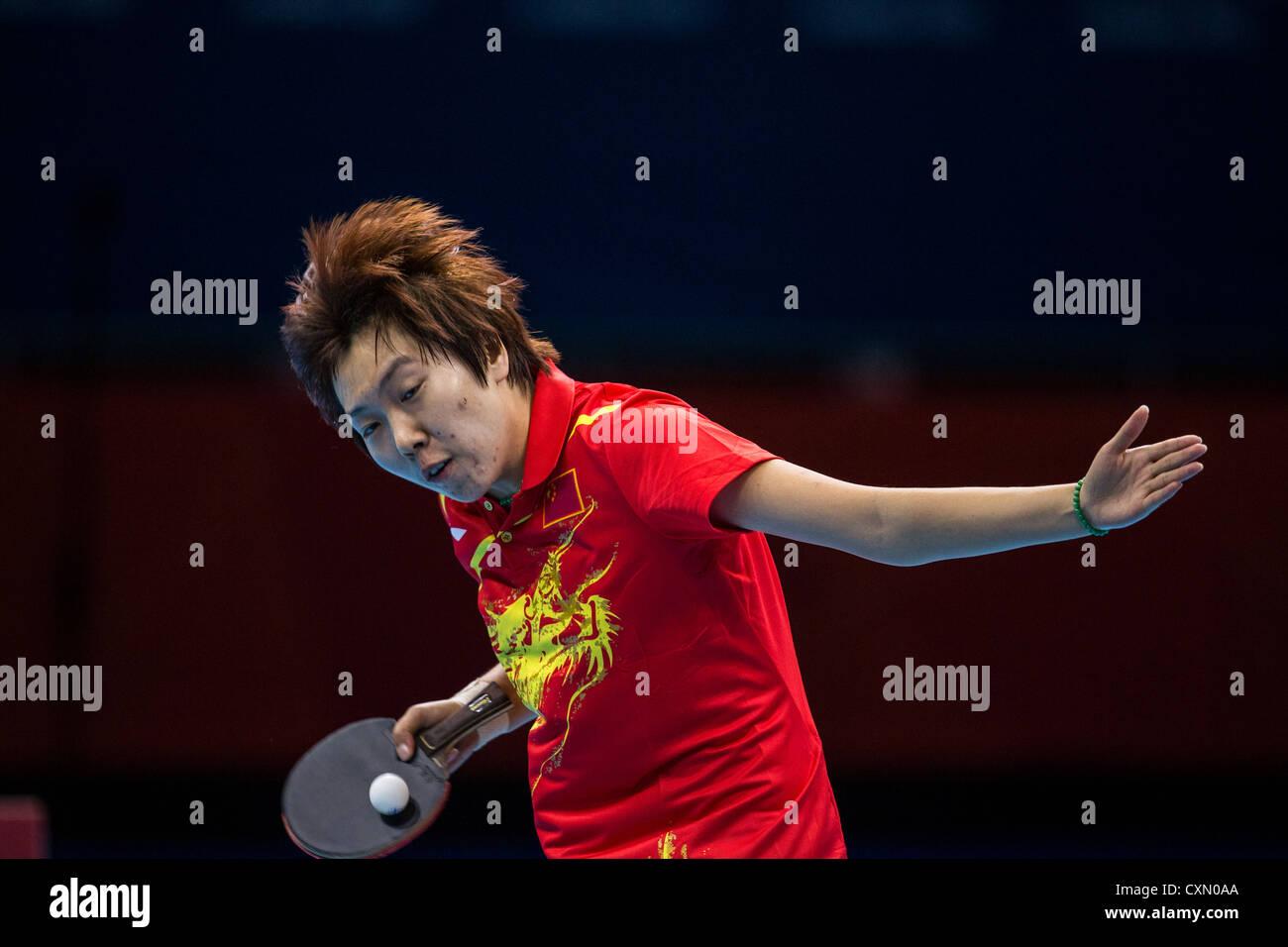 Li Xiaoxia (CHN) vince la donna ping pong medaglia d oro nelle Olimpiadi estive di Londra, 2012 Immagini Stock