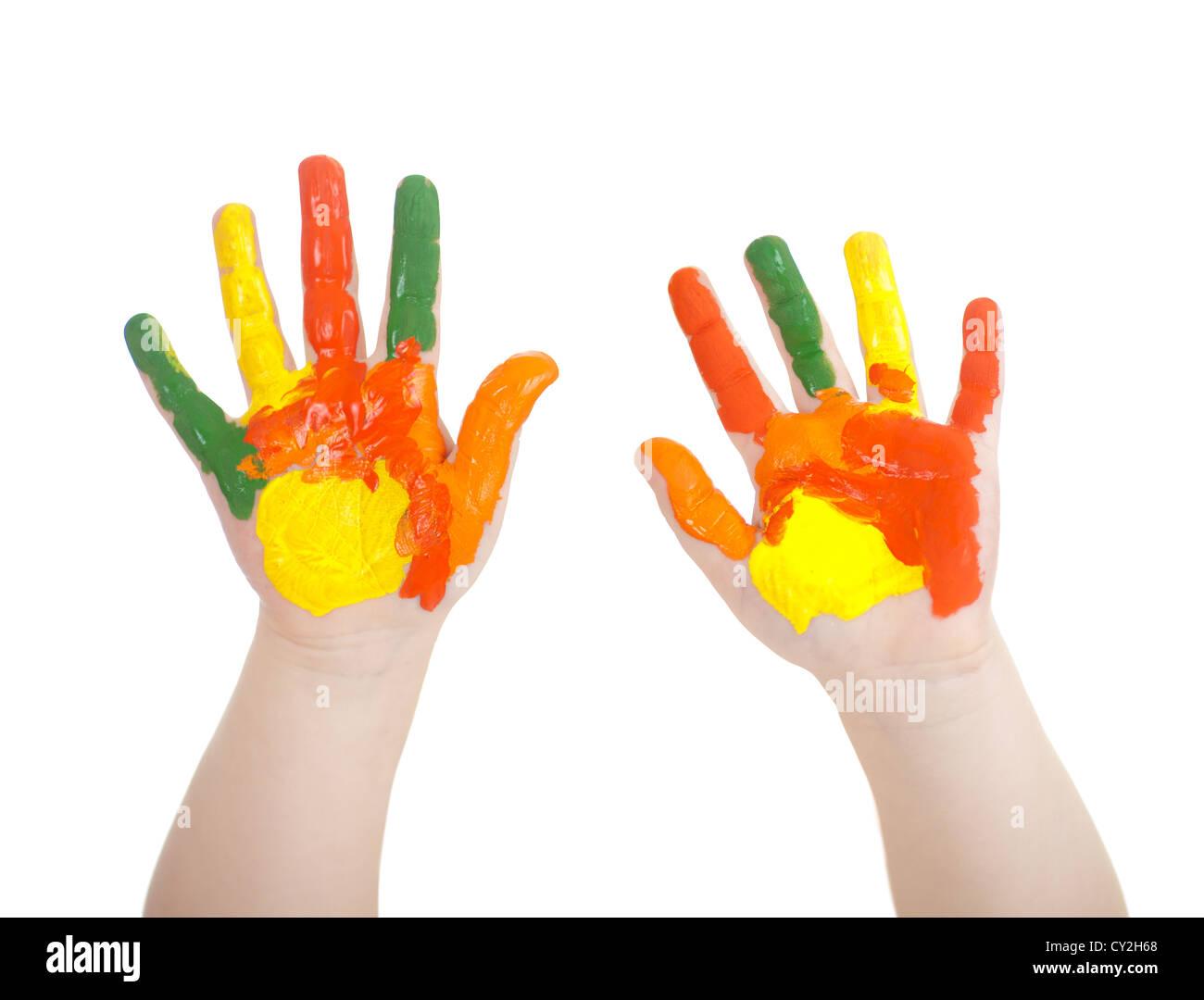 Il Kid's mani dipinte in colori luminosi isolato su bianco Immagini Stock