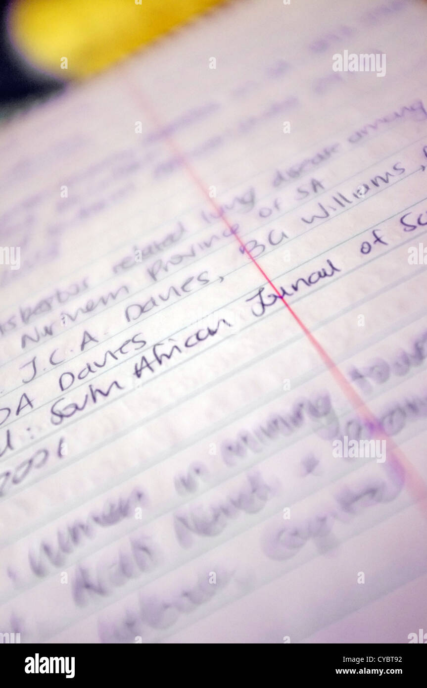 Notebook con la scrittura su di esso. Immagini Stock