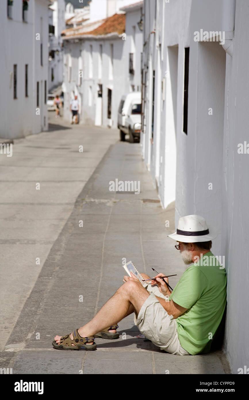 Artista di strada di verniciatura di un tipico villaggio bianco Malaga Mijas Costa del Sol Andalucía Spagna Immagini Stock