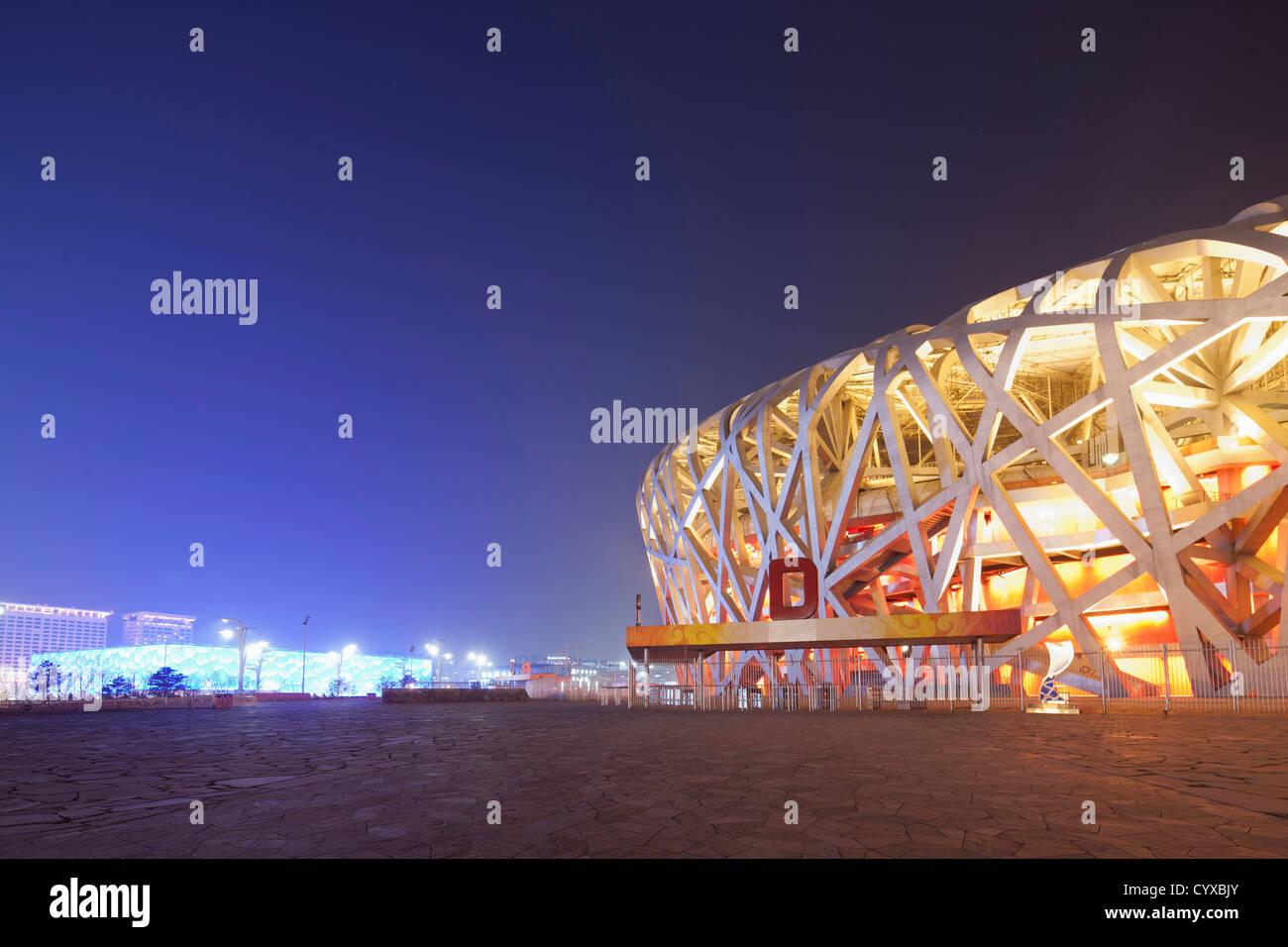 Cina, Pechino, National Stadium di notte Immagini Stock