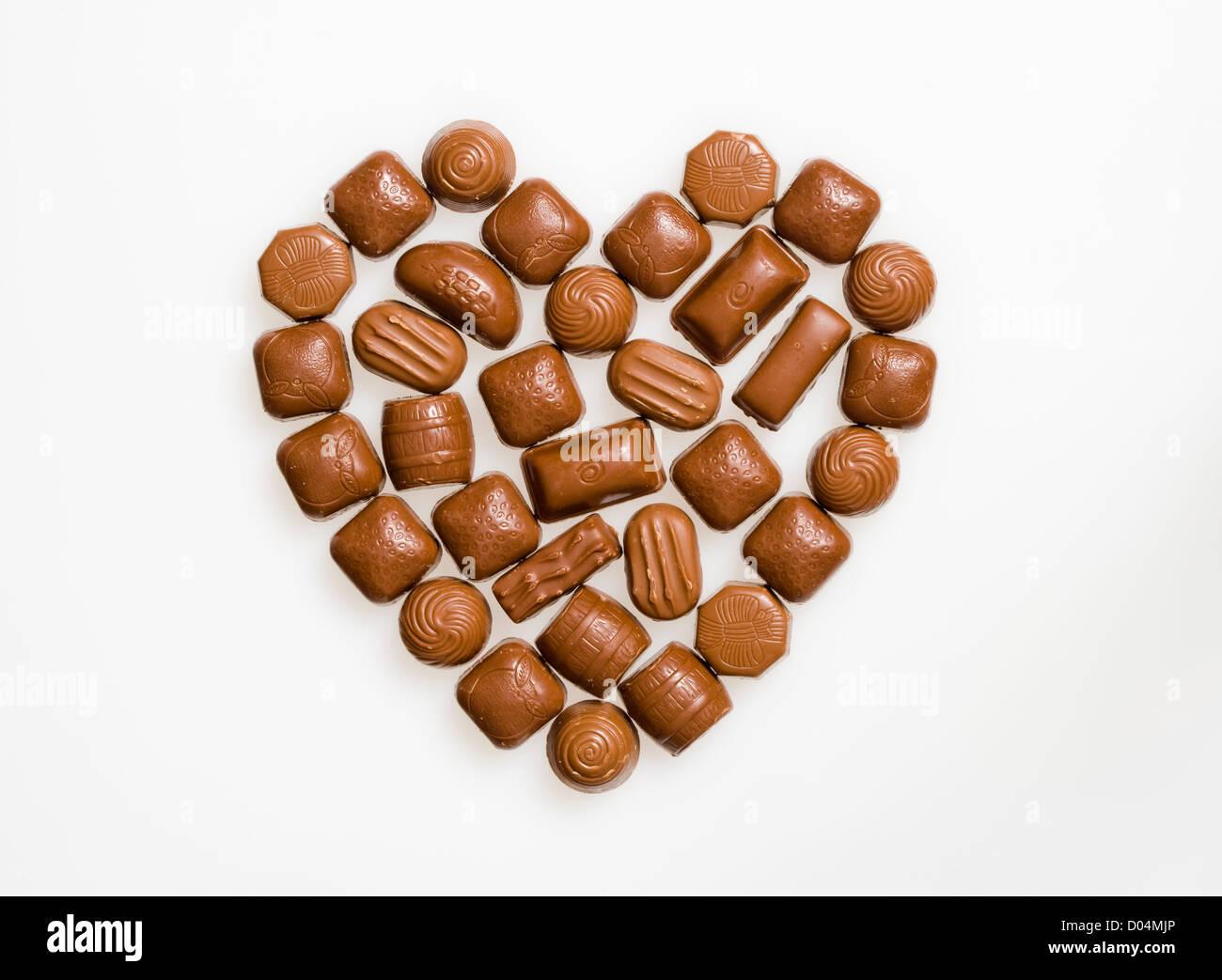 Cioccolatini a forma di cuore. Immagini Stock