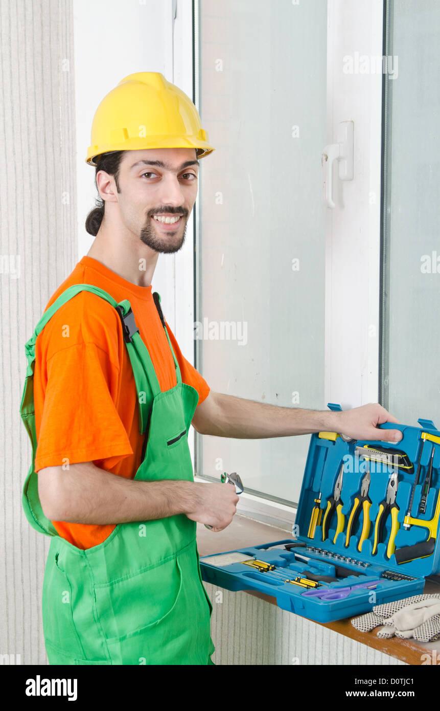 Repairman in tute in concetto industriale Immagini Stock